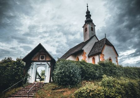 Church of Maria Worth at Lake Woerthersee near Velden in Austria during Summer - in the morning Фото со стока