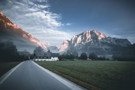 Old highway against mountains and a cloudy sky at the sunset in austria styria Stock fotó