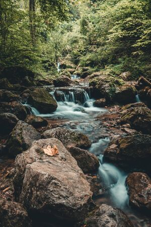 Beautiful waterfall in autumn forest in austria styria