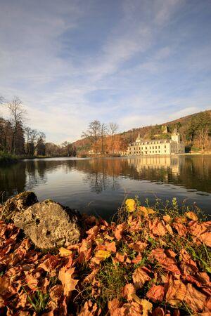 autumn lake in front of castle hernstein in austria