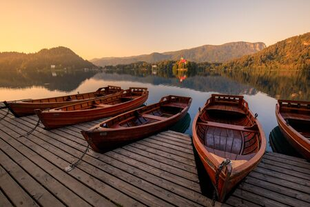 Lake Bled with boats at autumn background. Lake bled is famous place and popular European travel destination.
