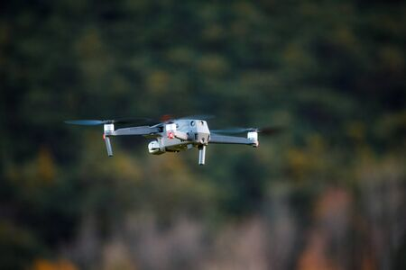 Drone is flying in the nature with space in background