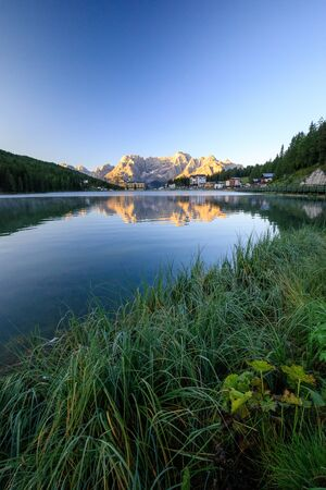 Mountain Reflection at Sunrise over Misurina Lake in the dolomites in italy