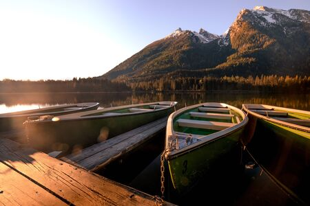 Colorful summer morning on the Hintersee lake with white pleasure launches. Splendid morning scene in Austrian Alps. Salzburg-Umgebung, Austria, Europe.