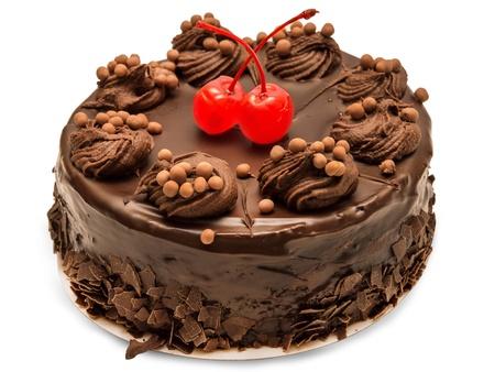 白い背景で隔離のチョコレート ケーキ 写真素材