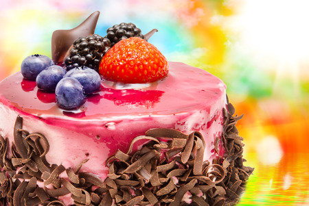 orange slice: Birthday fruit cake with fruits close up Stock Photo