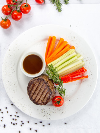 Mignon steak with demi-glace sauce, served with vegetables Banco de Imagens