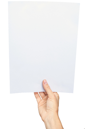 Women's hand holding a blank paper sheet, isolated on white.