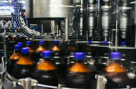 Plastic bottles moving on a conveyor belt