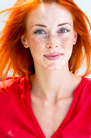 Portrait of a beautiful redhead freckled woman