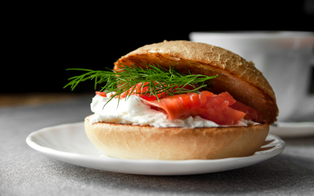 Closeup on sandwich with salmon and cream cheese