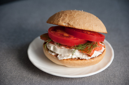 Sandwich with salmon, tomato and cream cheese Banco de Imagens