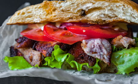 Homemade sandwich, juicy meat and fresh vegetables
