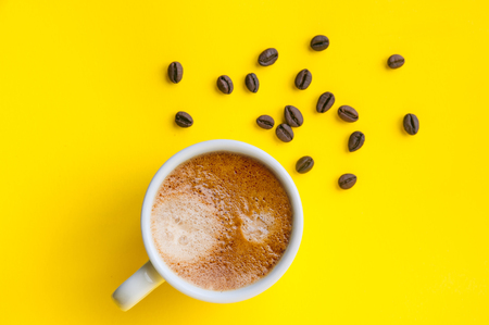 Cup of coffee and coffee beans, top view Banco de Imagens