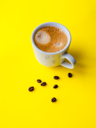 Cup of espresso and coffee beans, top view Banco de Imagens