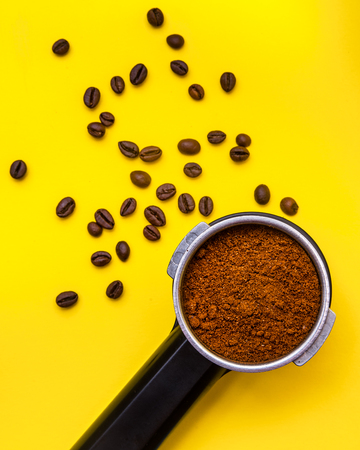 ground coffee and coffee beans, top view Banco de Imagens