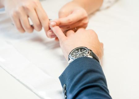 Man gets his manicure, hands closeup Banco de Imagens