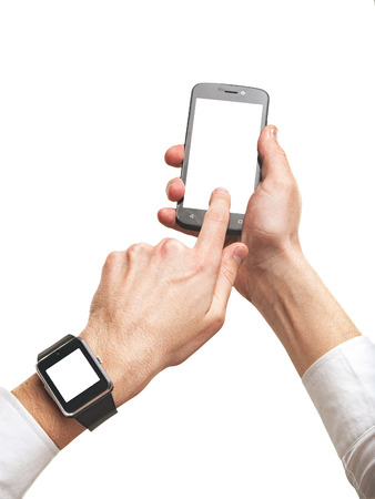Mans hands using smartphone and smartwatch, isolated