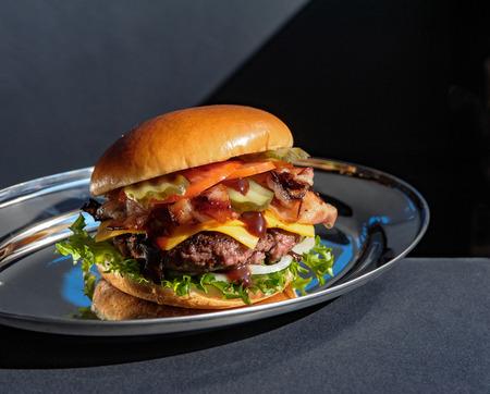 Juicy tasty burger on a metal plate Banco de Imagens