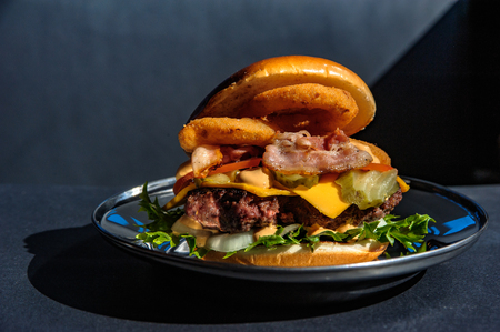 Juicy hamburger on a metal plate