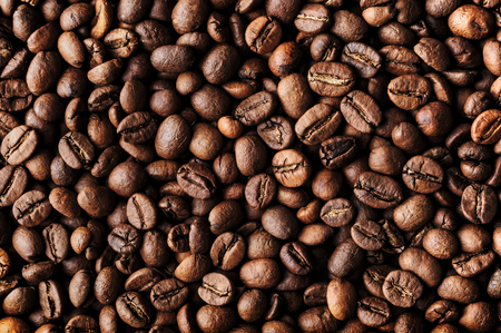 Roasted coffee beans, top view closeup
