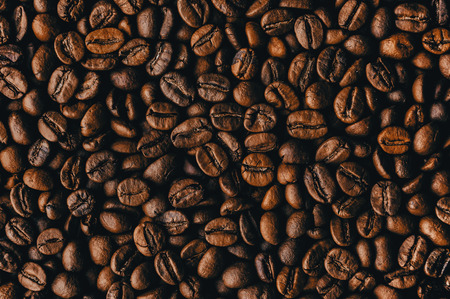 Roasted coffee beans, background texture Banco de Imagens