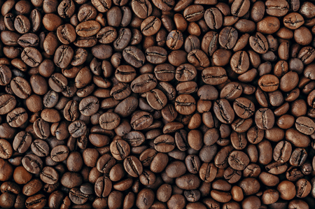 Roasted coffee beans, top view texture