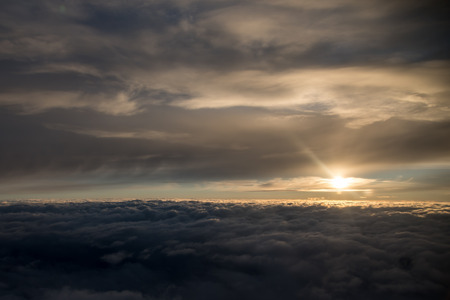 Sun over the clouds during a flight