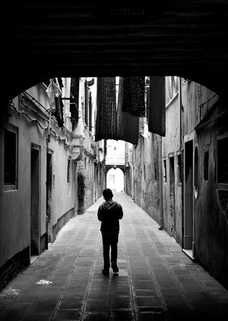 Young boy on a calle in Venice Stock Photo