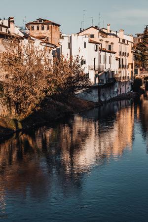 Buildings along the river bank Pauda Italy Stock Photo - 120089407
