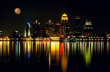 Night skyline of Louisville Kentucky with the full moon. Horizontal orientation. photo