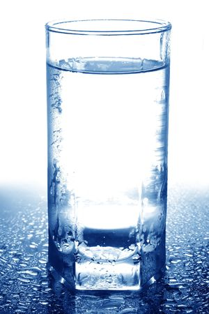 Glass full of water in blue and white colours