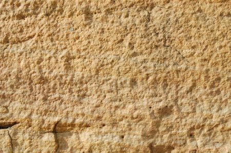 Light yellow stone textured background with cracks