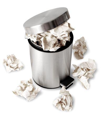 wastebasket: Wastebasket full up with crumpled paper. Isolated on white background