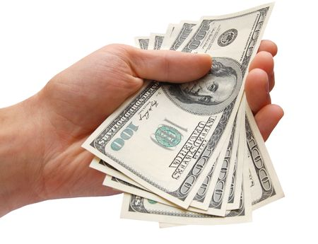Hand holding a stack of cash, isolated on the white background Imagens