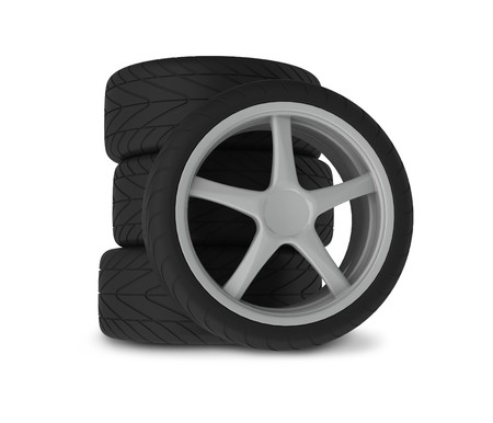 Heap of wheels with aluminium rims over the white background photo