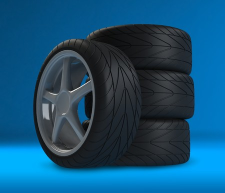 Heap of wheels with aluminium rims over the blue background Stock Photo - 4339579