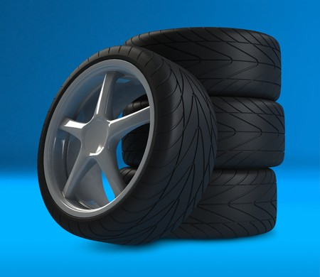 Heap of wheels with aluminium rims over the blue background Stock Photo - 4339580