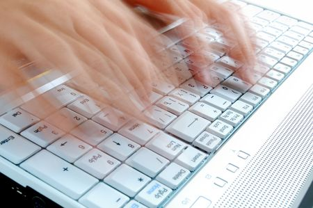 Fast Typing on Laptop Keyboard Stock Photo
