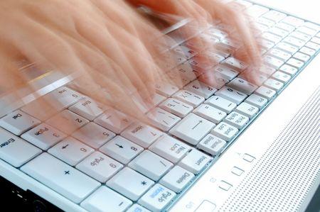 Fast Typing on Laptop Keyboard Stockfoto