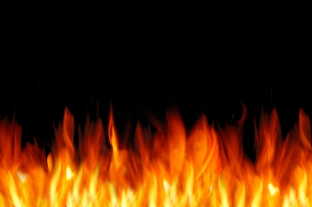 Bright fire wall on the black background. Free space for text