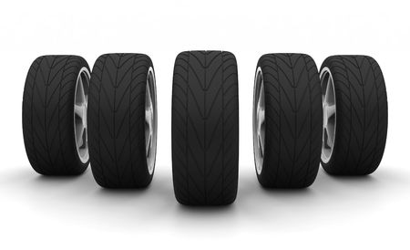 Perspective view of five new car wheels isolated on the white background. Front view photo
