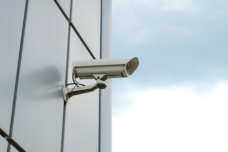 Security camera mounted on the facade of the modern building Imagens - 7156011