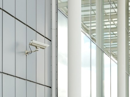 Security camera mounted on the facade of the modern building                                     Stock Photo - 7156013
