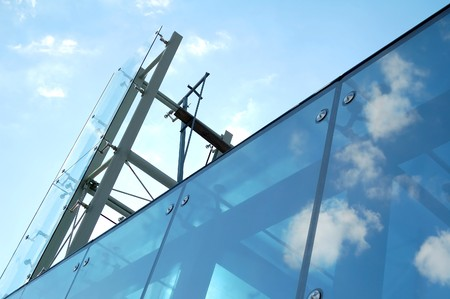 Modern glass and steel construction with blue sky Stock Photo