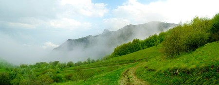 Panorama of Beautiful Mountain Landscape with Low Clouds Stock Photo - 7266522