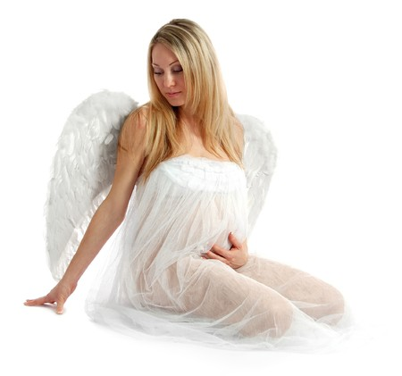 Portrait of a beautiful angelic pregnant woman photo