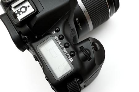 Professional Digital Single Lens Reflex Camera isolated on white photo