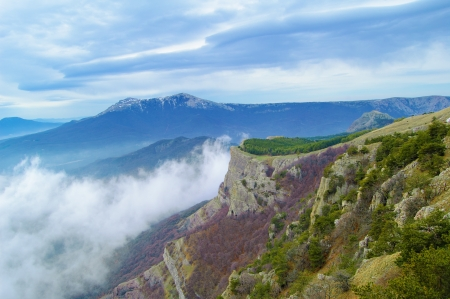 Beautiful Mountain Landscape with Low Clouds photo