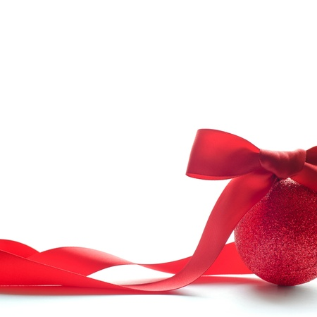 Red Christmas Ball With Big Red Bow and Long Ribbon on the White Background